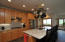 Granite counter tops and stainless appliances.