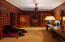 "Anteroom at ground level with access to elevator, stairway, ""ski locker""."