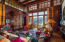 Magnificent scale in the Great Room with classic fir paneled walls for lodge ambiance