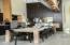 Dining and bar area boast custom SV Bronze light fixtures