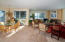 Large Living with lots of windows, light and fireplace,