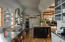 Open Chefs Kitchen with leather banquet, coffee bar, Thermador appliances, open shelving, stainless and large pre island.