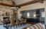 Great Room 20' ceilings looking into open Gourmet Kitchen