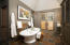 Master Bathroom with 2 pedestal sinks, shower, Toilet room and Large closet. Door leads to heated paver patio spa.