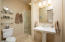 Guest bathroom en suite on separate E wing of the home by guest master