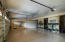 1161 sq ft garage with epoxy floor & substantial built in storage.