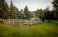 Situation on over a half acre of gorgeously landscaped grounds, there is an enclosed garden with raised beds and irrigation, a chicken coop, and storage for your outdoor toys and tools.