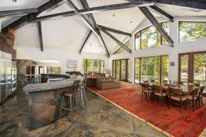 Huge open great room with tons of light and views. 17' ceilings, exposed steel beams with underlighting. Floor to ceiling windows oriented towards the west overlooking the Big Wood River and nearby mountains.