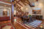 Foyer and dining area. High ceilings, with reclaimed wood ceiling joists.