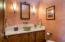 Main floor powder room with beautiful whit slab granite countertop.