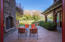 Front patio with fireplace and expansive Lane Ranch cliffs.