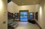 Massive pivot front entry door