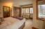 Guest bedroom enjoys multiple views