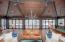 All glass Nanawall doors open for a treetop indoor-outdoor game room