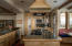 Custom cabinets, two sinks, gas cooktop, double ovens, sub zero frig and walk in pantry