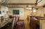 Dining area with custom cabinets and wet bar
