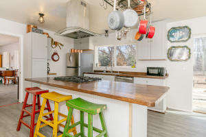 Remodeled kitchen includes: Custom hand-made wood kitchen counters with Antique glass pulls on new cupboards; brand-new stainless-steel appliances, brand-new hood, brand-new Frigidaire gas range, new lighting and ceiling fan.