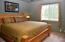 Inviting, comfortable, guest bedroom with ample space!