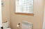 A master bathroom affording plenty of space, privacy, and relaxation!