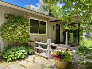 Welcoming covered porch, flagstone walk and split rail fence