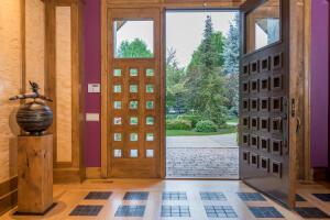 Icelandic birch wood veneer on walls. 3 inch solid core door, Rocky Mountain Hardware throughout