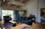 Living room opens to a creekside deck