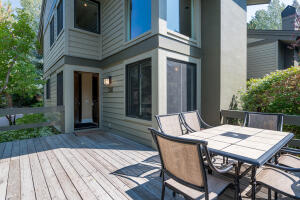 End unit boasts an abundance of natural sunlight and privacy