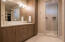 Primary bath suite has heated tile flooring