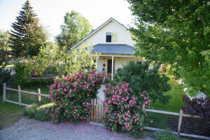 Charming Bungalow Nest Home. Arbor with Henry Baffin Roses.