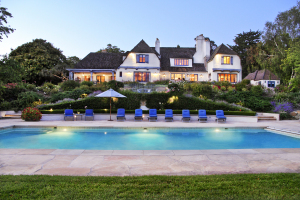 Elegant 1928 French Normandy Country Manor serenely resting on nearly 2 acres.