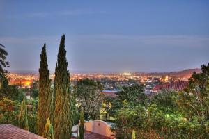 Santa Barbara at dusk glistens from this amazing Riviera estate.
