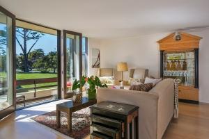 Floor-to-window ceilings, maple flooring, beautiful views