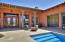 Front courtyard entry with pool and gas fire pit