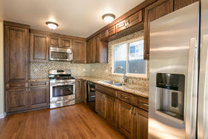 Kitchen with new cabinets, Granite counters, and Stainless appliances