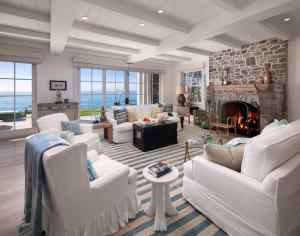 Beyond the foyer, a truly stunning great room conveys the casual mood inspired by coastal living.