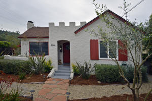 Charming 1926 home with mature, lush landscaping in front and back. Surrounded by large hedges, side fence and wall, privacy abounds!