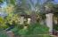 lush landscaping and pergola