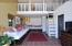 Utilize this loft-space off the kitchen as a playroom or storage for seasonal treasures.