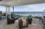 Expansive covered patio with ocean views and 150 beachfront