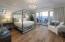 Guest bedroom en suite with French doors opening to deck