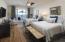 Guest bedroom with French doors opening to deck, en suite