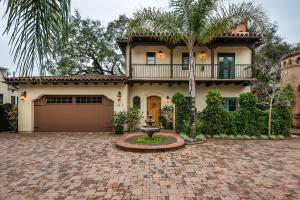 Welcome home to this stunning Spanish Colonial home, located down a private lane 1.5 blocks off State Street.