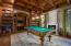 Library with Custom Wood Detailing, a Bar & Private Bath.