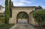 Stone Porte-Cochere Accessing Rear Motor Court with 5 Car Garage
