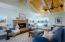Open floor plan with high beam ceilings over gorgeous living room that's made for entertaining