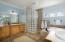Master bath with deep soaking tub and large shower