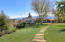rolling lawns surrounded by mountain views