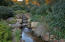 Re-circulating Sandstone-lined Stream runs through magical Gardens.