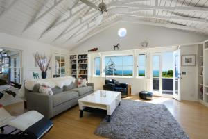 Views out to the ocean and Channel Islands, vaulted ceilings, and maple hardwood floors.