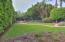 Front yard enjoys sprawling lawn & walkways